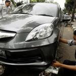 Dinas Perhubungan Kerjasama dengan Polisi dan Lurah Atasi Mobil yang Diderek